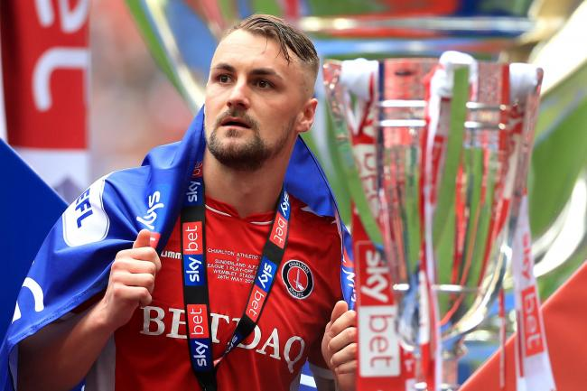 Charlton Athletic's Patrick Bauer celebrates with the Sky Bet League One Play-off Trophy after the Sky Bet League One Play-off final at Wembley Stadium, London.