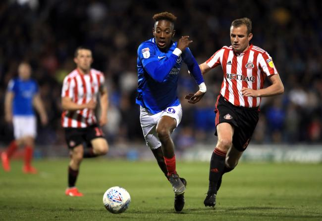 Portsmouth's Jamal Lowe (left) and Sunderland's Lee Cattermole battle for the ball during the Sky Bet League One Play-off, Semi Final, Second Leg match at Fratton Park, Portsmouth.