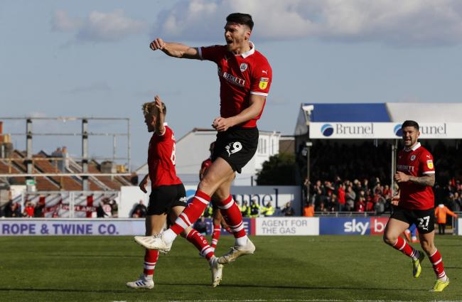 Barnsley's Kieffer Moore celebrates scoring his teams first goal against Bristol Rovers during the Sky Bet League One match at Memorial Stadium, Bristol.