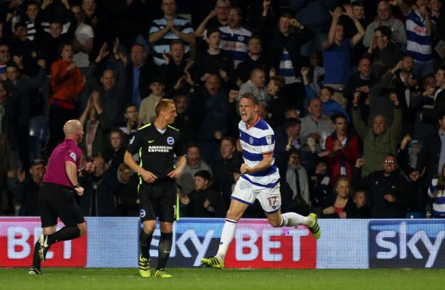 Queens Park Rangers' Matt Smith (right) celebrates scoring his side's first goal of the game during the Sky Bet Championship match at Loftus Road, London.