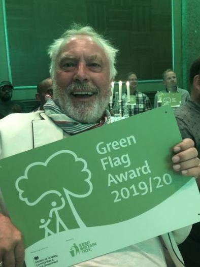 Nick Day holding one of the three Green Flag Community Awards gained by Friends of Plumstead Common at the ceremony on 17th July