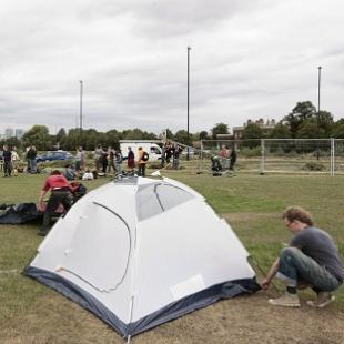 Climate change protesters begin setting up the Climate Camp on Blackheath