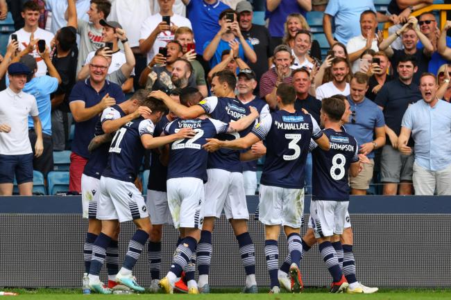 Millwall's Jed Wallace (obscured) celebrates scoring his side's first goal of the game during the Sky Bet Championship match at The Den, London.