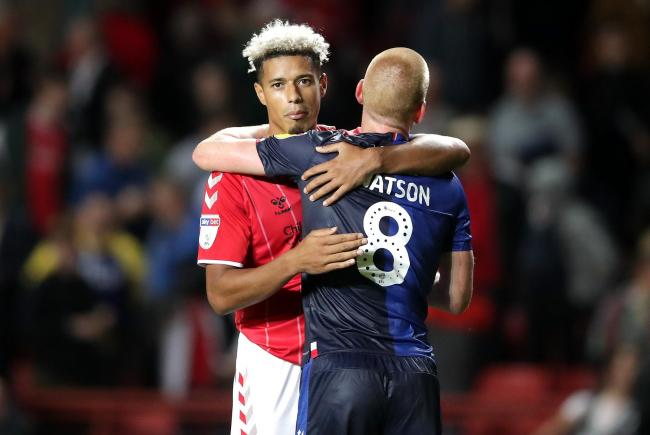 Charlton Athletic's Lyle Taylor (left) and Nottingham Forest's Ben Watson after the final whistle during the Sky Bet Championship match at The Valley, London.