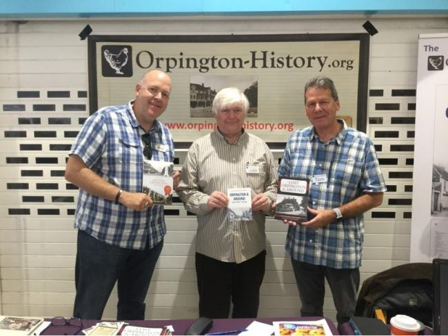 (From left) Phil Waller, Lord Avebury, and Tom Yeeles with Orpington History's publications