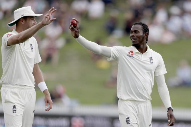 England's Jofra Archer and teammate Stuart Broad