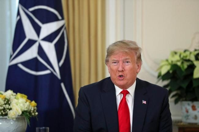 US President Donald Trump at a breakfast meeting with Nato secretary general Jens Stoltenberg at Winfield House