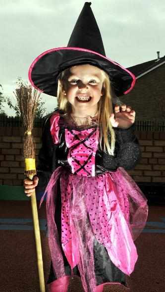 News Shopper: Pictured in her witch outfit is Amy Powley, aged five.