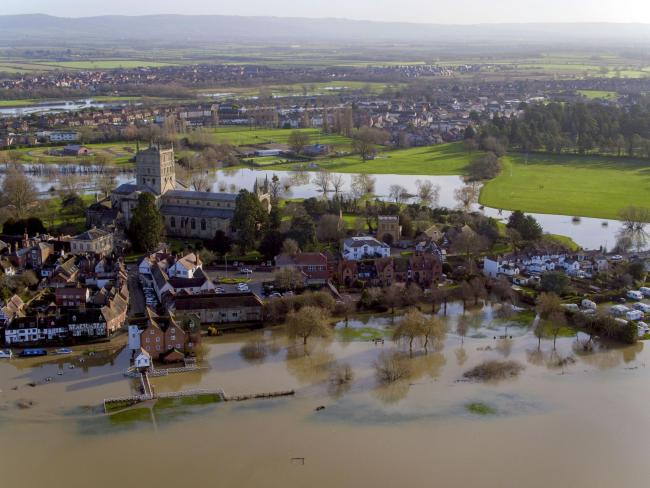 Flood water still surrounds  Tewkesbury in Gloucestershire after the recent rain from storm Brendan. Image: Steve Parsons/PA Wire