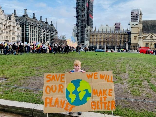 6-year-old Evan attends a climate protest in central London.