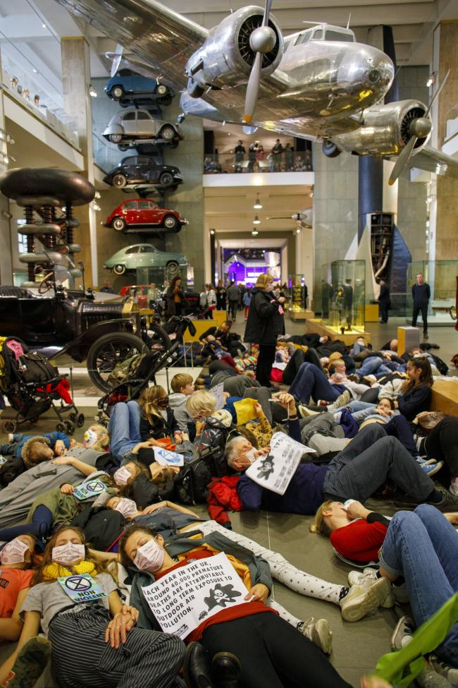 Handout photo issued by Extinction Rebellion UK of activists protesting in Making the Modern World gallery at the Science Museum in London (Crispin Hughes/Extinction Rebellion UK)