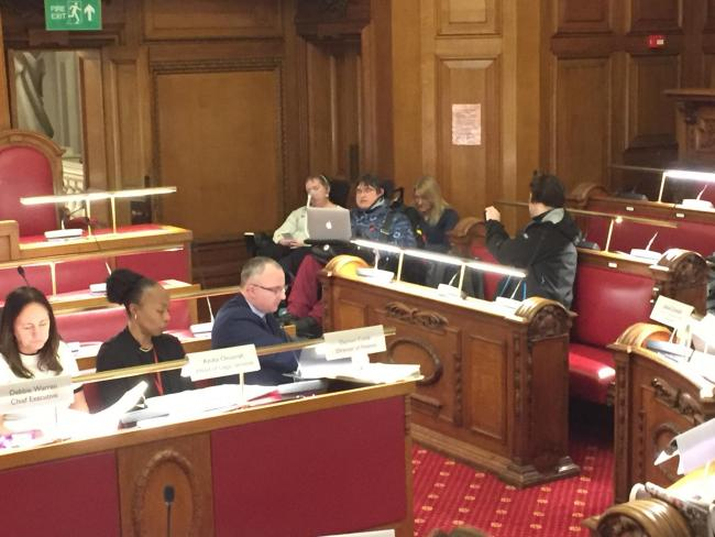 Jenny Hurst, a co-founder of Greenwich Disabled People Against Cuts, addresses councillors.