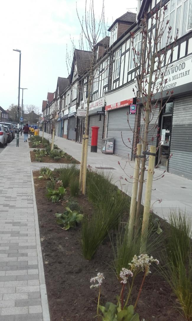 Some of the completed regeneration work alongside The Green at Falconwood Parade.