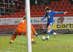 News Shopper: Danny Schofield stuns the home fans with his late, late equaliser. ROSS EVANS.