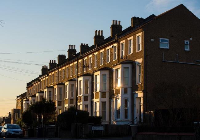 Terraced residential houses in south east London. Four rogue landlords have been fined by Greenwich Council for illegally renting out HMOs without a license. Dominic Lipinski/PA Wire