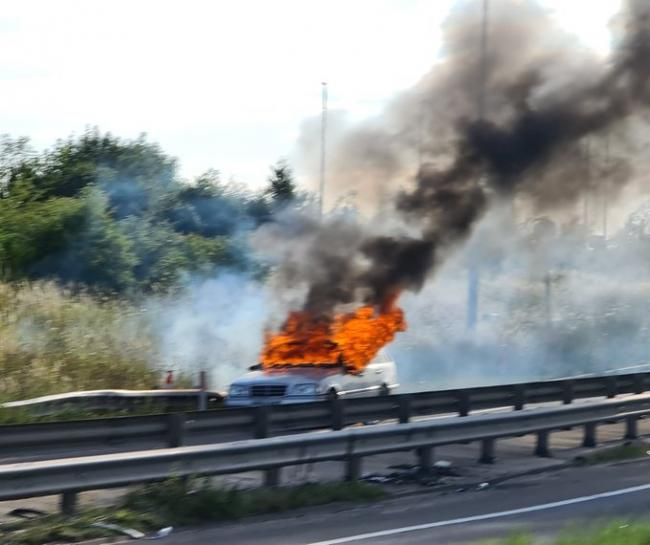 Two men have been arrested in Gravesend after a Mercedes was found ablaze on the A2 slip off to Henhurst Road on Sunday.