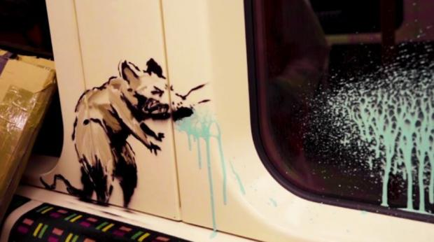 News Shopper: Banksy's sneezing rat reminds us of the dangers of passing on the virus on public transport (Photo: Banksy).