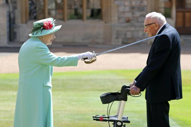 News Shopper: Capt Sir Tom is knighted by the Queen