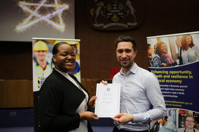 Desline McLeggan receives her certificate for successfully participating in the Lewisham Apprenticeship Programme in 2019