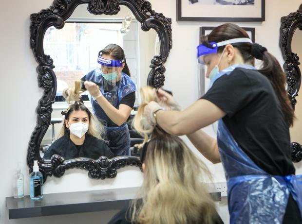 There are calls for barbers to wear face masks