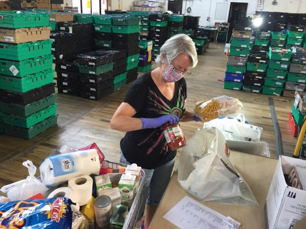 News Shopper: Volunteer Helen Davis of Bromley packs a kit with seven days worth of meals. Picture: Lachlan Leeming