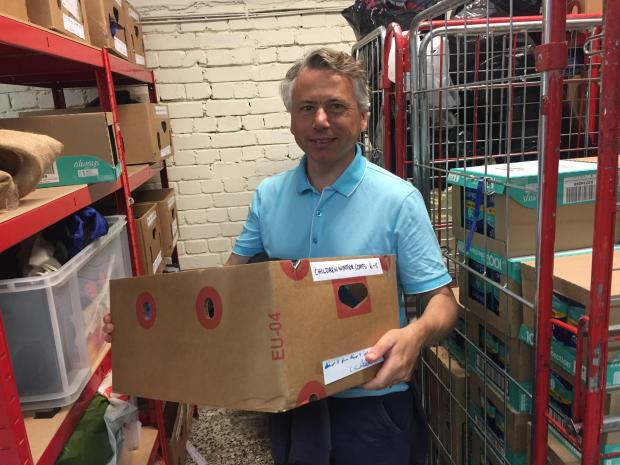 News Shopper: Trustee Robert Keeling moves a box of supplies within GRACE's Lee base. Image: Lachlan Leeming