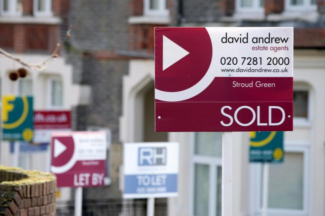 Sold, To Let and Let By estate agent signs placed outside homes in north London (Yui Mok/PA)