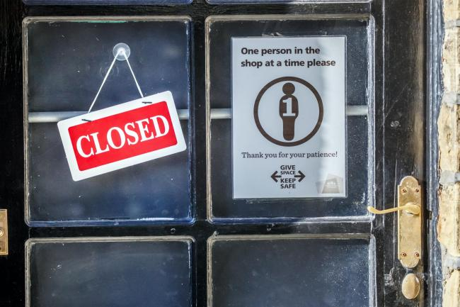 A 'Closed' sign on a shop door
