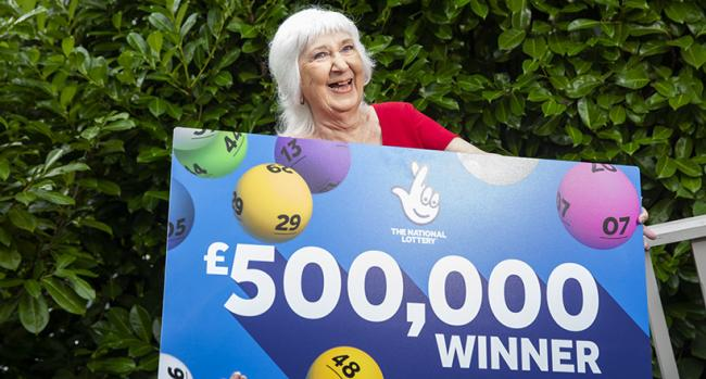 Sheila Garrett celebrates her £500,000 Thunderball win on The National Lottery. Photo: James Robinson / www.James-Robinson.co.uk - Camelot