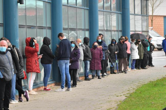 Members of the public queue for a Covid-19 test at Rhydycar leisure centre in Merthyr Tydfil