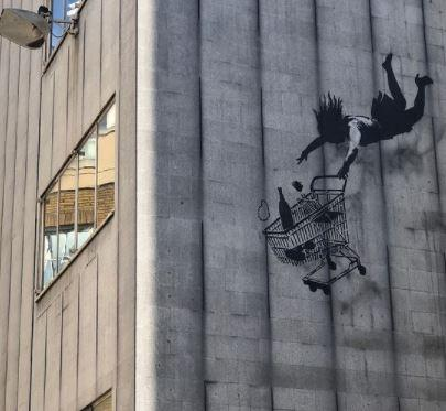 News Shopper: Banksy's 'Falling Shopper' mural is hidden storeys above London's street level, surviving unscathed