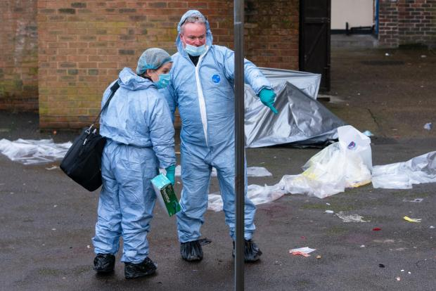 News Shopper: Forensics specialists at the scene of a fatal stabbing at flats on Wisbeach Road, in Croydon, London. Image: Dominic Lipinski/PA