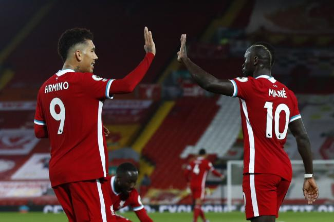 Liverpool forwards Roberto Firmino and Sadio Mane high-five each other