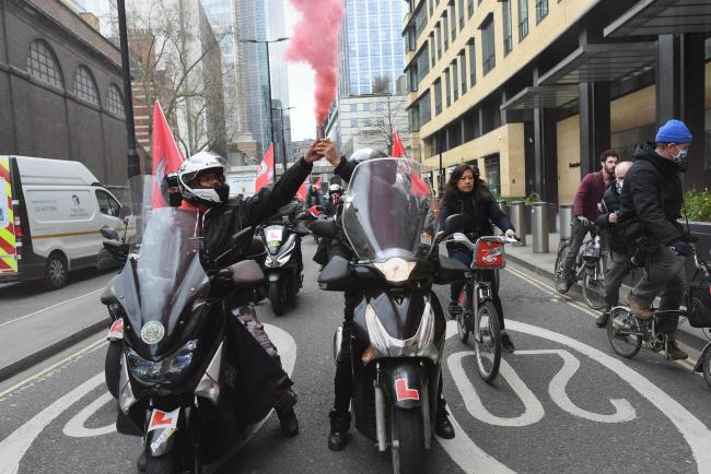 Deliveroo riders from the Independent Workers' Union of Great Britain (IWGB) in Shoreditch High Street, east London, as they go on strike in a dispute for fair pay, safety protections and basic workers' rights (PA)