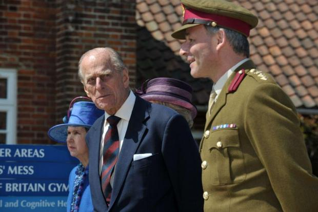 News Shopper: The Prince on a visit to wounded soldiers at Headley Court