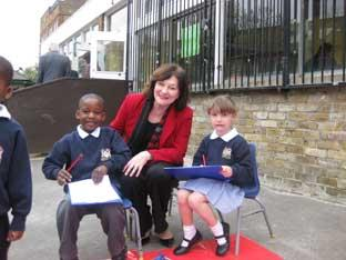 Joan Ruddock with Haberdashers' pupils