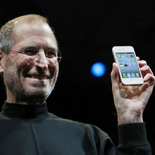 News Shopper: Apple CEO Steve Jobs with the new iPhone at the Apple Worldwide Developers Conference in San Francisco