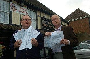 Landlord of Sir John Franklin pub Gary Snell and with secretary of Greenhithe Community Group,Tim Carrington with their petition last year
