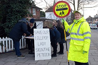Lollipop lady Pearl Adams with protesters outside Hayes Primary School