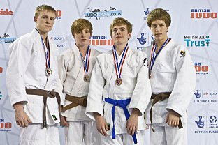 Charlie Whittaker (second right) is pictured with his medal