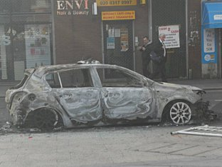News Shopper: Woolwich riots - burnt out car