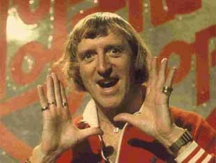 News Shopper: NOW THEN, NOW THEN: Jimmy Savile as the presenter of the BBC's flagship pop music programme Top Of The Pops