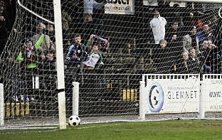 Joseph-Dubois' shot hits the back of the net to the delight of Bromley fans behind the goal