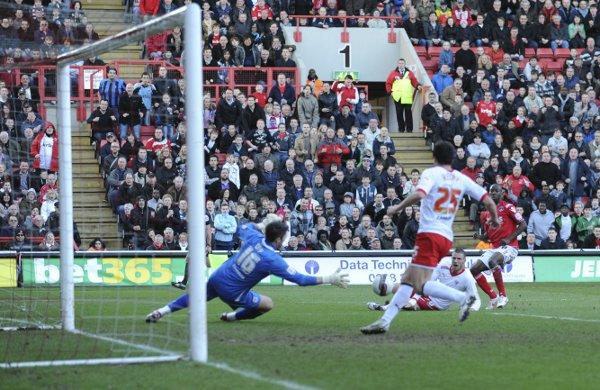 Bradley Wright-Phillips scores Charlton's second goal on saturday. PICTURES BY ALAN STANFORD.