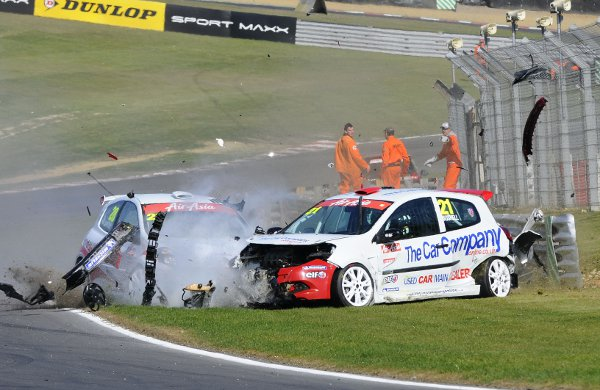 Mike Bushell (21)  crashes out with Nic Hamilton in race two
