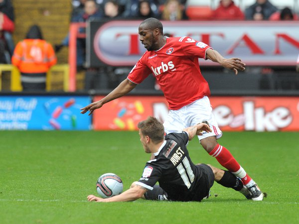 N'Guessan gets the better of Walsall's Kevan Hurst