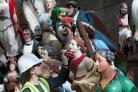 Some of the figureheads receiving finishing touches