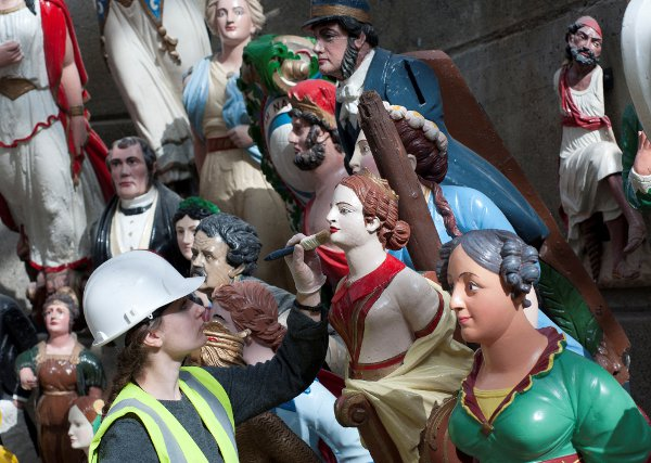 Some of the figureheads receiving finishing