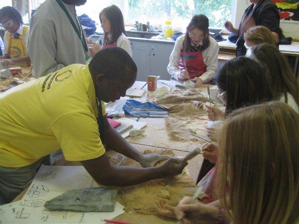 Pupils try soapstone carving at Ravensbourne School as part of the Swift Weavers project