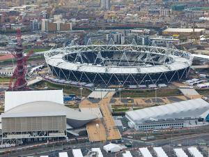 READY FOR BUSINESS: An aerial view of the Olympic Park showing the Olympic Stadium with the Aquatics Centre and Water Polo arena in the foreground